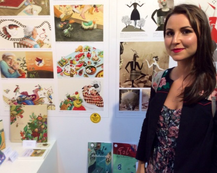 New Blood best in show winner Fiona Rose in front of her work
